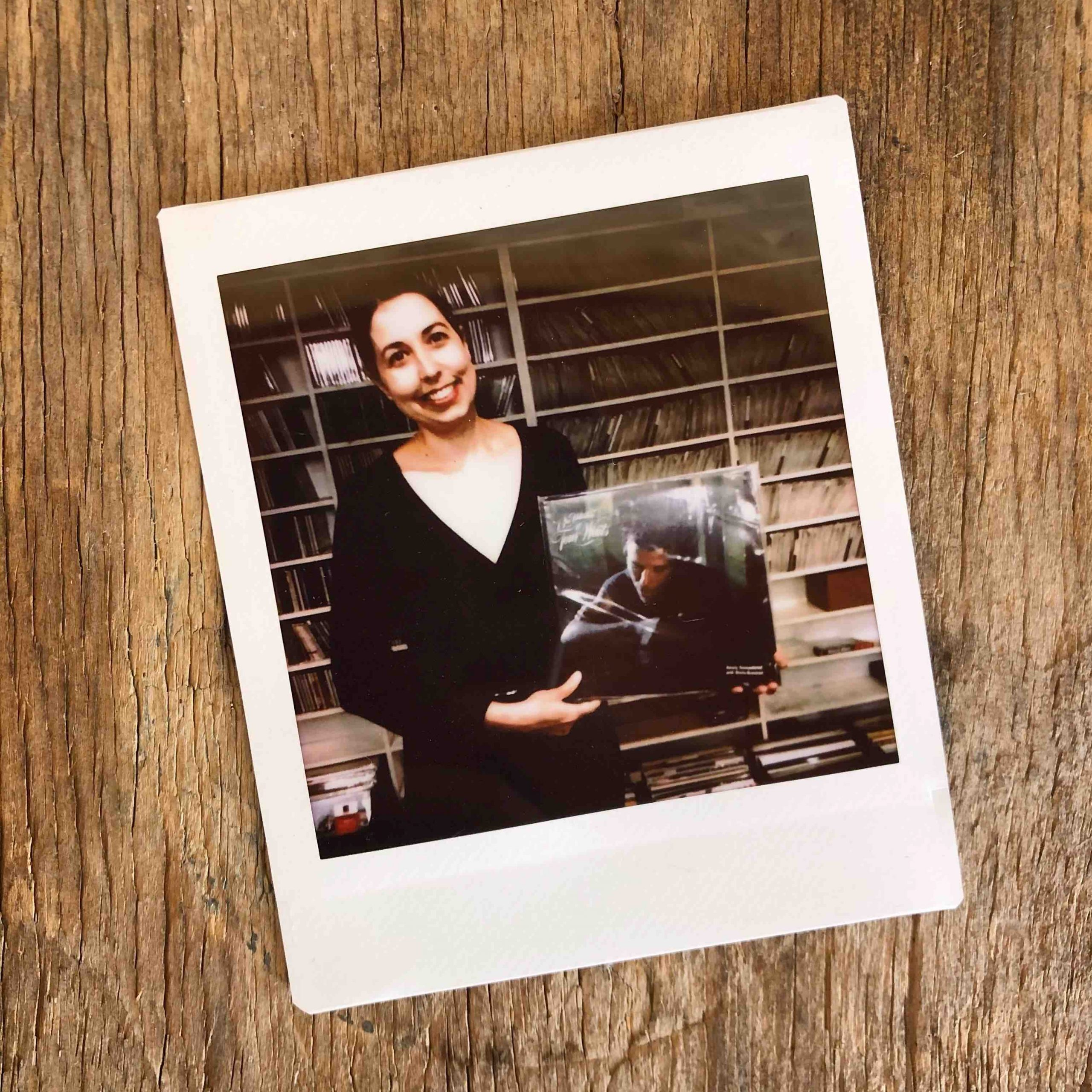 Polaroid of girl holding a Tom Waits record